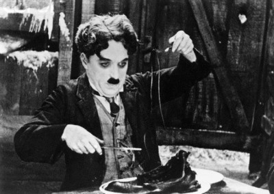 Charlie Chaplin eats a shoe in the 1925 film The Gold Rush.