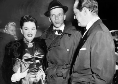 Frank Sinatra, Judy Garland and her husband Sid Luft pose together at the premier of Sinatra's film The Man With The Golden Arm in 1955.