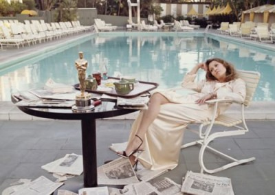 Faye Dunaway lounges by the pool the morning after the Oscars (1977)